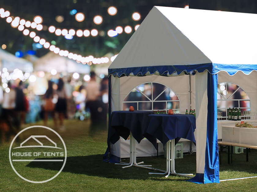 A stylish blue-white marquee used at an outdoor evening event