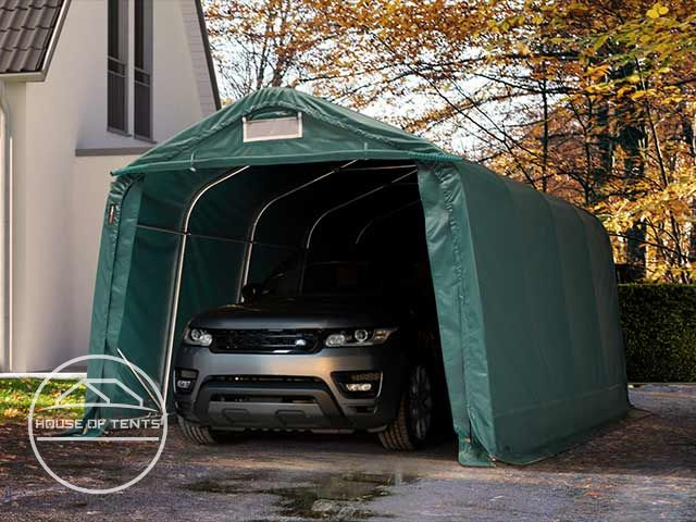 A caravan and a car, safely sheltered in a portable garage.